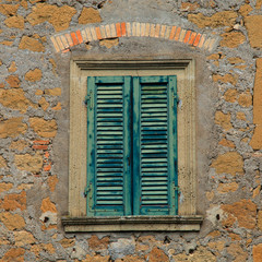 Old wooden window with green shutters