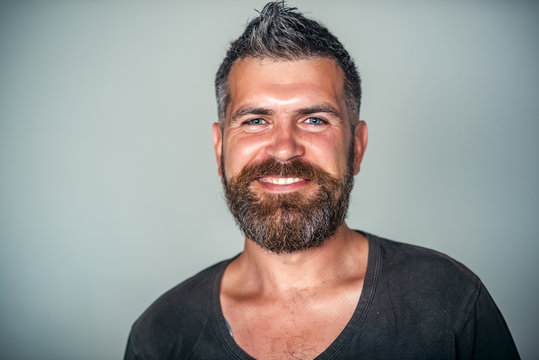 Man happy smile on bearded face with stylish haircut