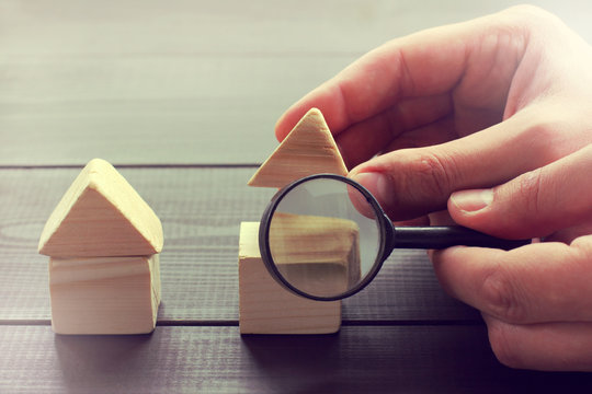 advertising construction objects/ realtor shows parts of the house in magnifying glass