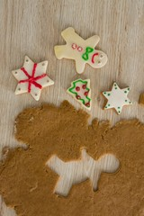 Gingerbread dough with star shapes on wooden table