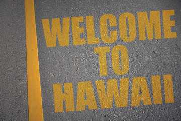 asphalt road with text welcome to hawaii near yellow line