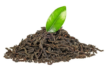 Dry black tea with green leaf isolated on white background