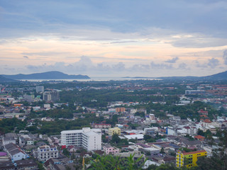 This is a panoramic view on the mountain viewpoint. See the city and the sea in the distance. Beautiful evening sky It is a great place to take pictures and relax.
