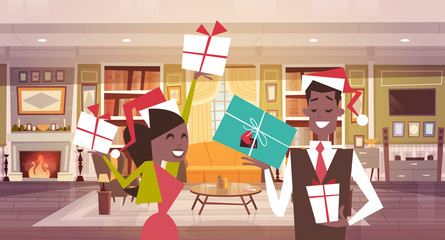African American Couple In Santa Hats Holding Present Boxes In Living Room, Merry Christmas And Happy New Year Celebration Banner Vector Illustration