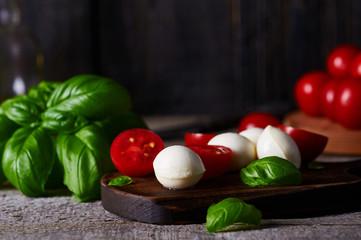 tomatoes basil leaves and mozzarella