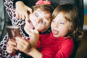 Little girls children kids taking selfies at home