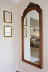 Wooden framed mirror on wall