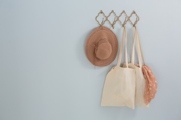 Hat, grocery bag and scarf hanging on hook