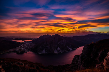 Fotomurales - panoramic view to Lecco Lake at sunset with lenticular clouds - Lake Como district Lombardy Italy