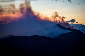 woodland fire in Alps mountains - Lake Como district Lombardy Italy