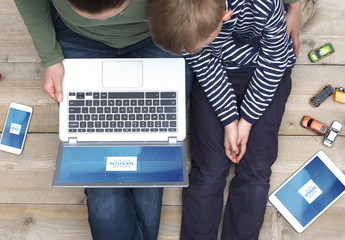 Top View Mockup of Mother and Son Sitting on Floor with Devices and Toys 1