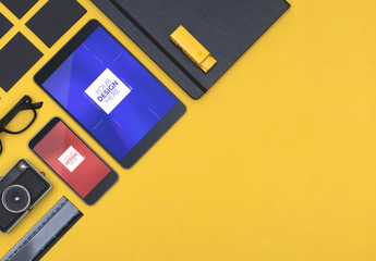 Mockup of Tablet and Smartphone on Yellow Background with Desk Accessories
