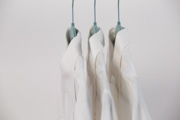 Close-up of shirts hanging on hanger