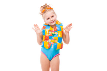 Beautiful little girl in in blue swimming suit and colorful life jacket