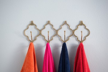 Colorful towels hanging on hook