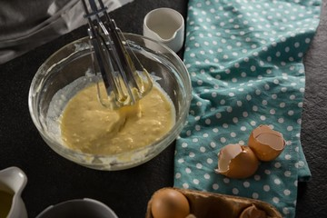 Freshly whisked batter of beaten eggs, milk and butter in a bowl