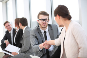 handshake colleagues at meeting in office