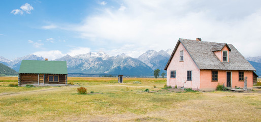 Mormon Row - Craggy Tetons form a wonderful backyard to these abandoned houses