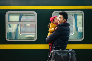 Father and daughter at the station platform