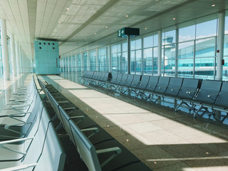 A picture of a brand new departure lounge at the airport terminal. Empty seats.