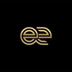 Initial lowercase letter ez, linked outline rounded logo, elegant golden color on black background