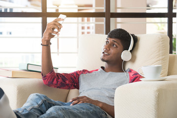 indian teenage male listening to music