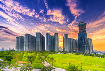 Ho Chi Minh City, Vietnam - November 30th, 2017: Panoramic skyscrapers at sunset with sky impressive in apartment, architectural extended life material development people in Ho Chi Minh City, Vietnam