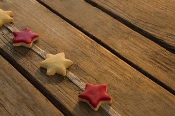 High angle view of star shaped cookies arranged on ribbon at