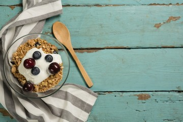 Bowls of breakfast cereals and fruits with yogurt