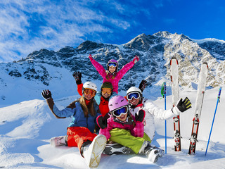 Skiing family enjoying winter vacation on snow in sunny cold day in mountains and fun. Solda, Italy.