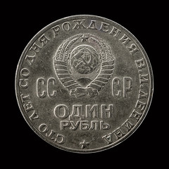 Soviet ruble against the black background.