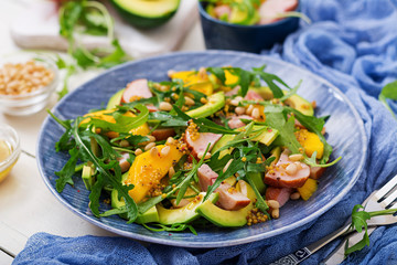 Holiday salad with smoked chicken, mango, avocado and arugula