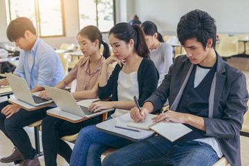 Group of Asian students are studing in classroom, learning and education concept