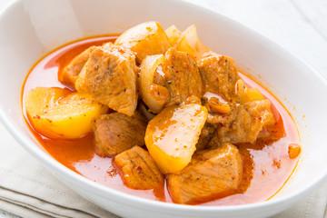 Massaman pork curry on wood background. Coconut milk curry.