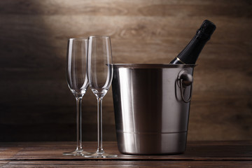Image of two empty wine glasses, bottle of champagne
