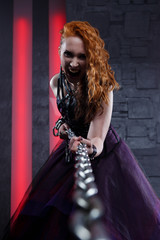 Picture of screaming vampire woman pulling iron chain