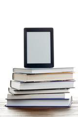 Picture of blank black picture frame on stack of books