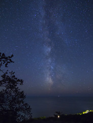 Starry night . The Milky Way over the sea.