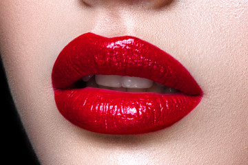 Close up of woman lips with red lipstick.