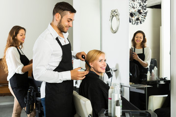 Man hairdresser doing hairstyle