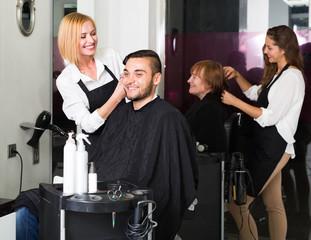 Young man at the hair salon. .