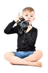 Attractive boy photographer, sitting isolated on white background