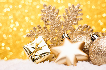 Christmas composition of Christmas tree toys on a gold background