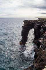 Stone shore of the island in Hawaii. Volcanic island