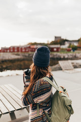 Woman with backpack and camera