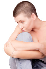 Sad woman with bald haircut with bare shoulders on isolated white background