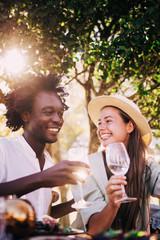 Cute mixed race couple enjoying wine together