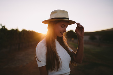 Countrygirl on farm in sunset