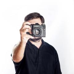 Man hold in front of him old retro vintage soviet camera