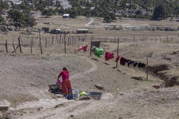 Mexico, Chihuahua State, Sierra Tarahumara, Tarahumara woman washing clothes